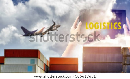 """Logistics Concept. """"LOGISTIC"""" words in yellow color on tabled in hands and freight container and airliner background. - stock photo"""