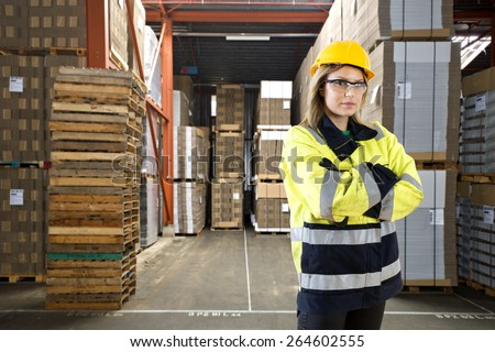 Logistics employee in a large distribution warehouse - stock photo