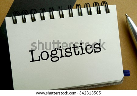 Logistics memo written on a notebook with pen - stock photo