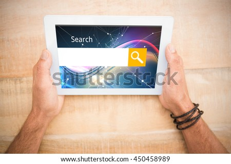 Logo of a search bar against hands holding blank screen tablet - stock photo
