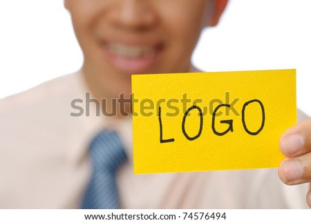 Logo words on yellow card holding by business man, closeup image. - stock photo