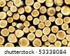 Logs stacked after trees have been felled - stock photo