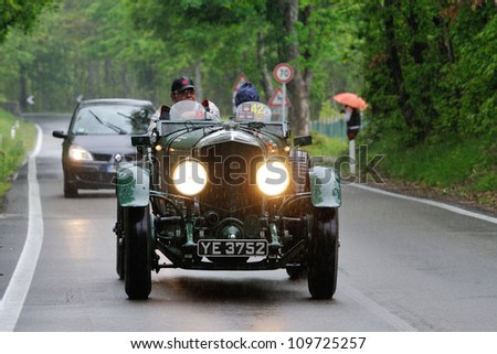 LOIANO (BO) ITALY - MAY 19: Green Bentley Speed Six built in 1927, driven by G. Ford, followed by modern Renault, takes part to the 1000 Miglia 2012, on May 19, 2012 in Loiano (BO)