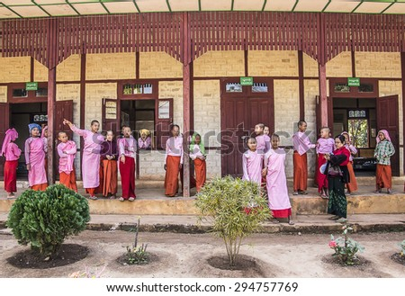 LOIKAW, MYANMAR - FEBRUARY 5, 2015: Nuns standing in front of their nunnery at Loikaw, Myanmar - stock photo