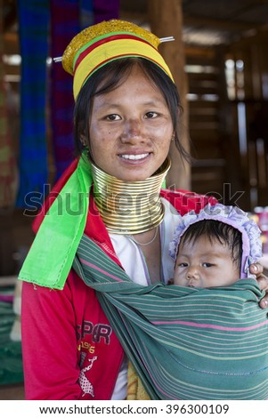LOIKAW, MYANMAR - JANUARY 23, 2016: A portrait of a woman and baby from the Padaung tribe who are famous for wearing large brass coils around their neck