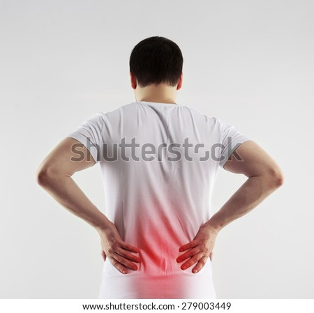 Loin inflammation on male body indicated with red spot. Health care and medicine concept. - stock photo