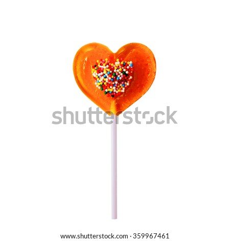 lollipop a heart shaped with confectionery sprinkles. bright yellow lollipop with candy sprinkles for wedding dessert, isolated on a white background - stock photo