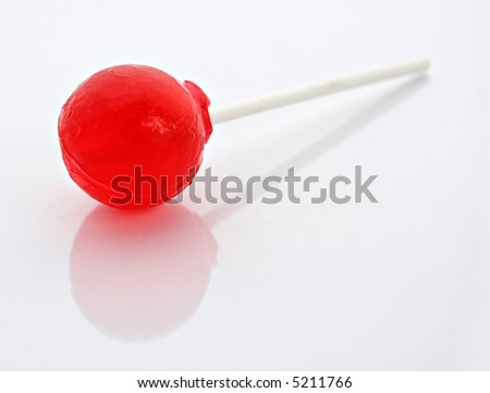 Lollipop on white background with gentle reflection - stock photo