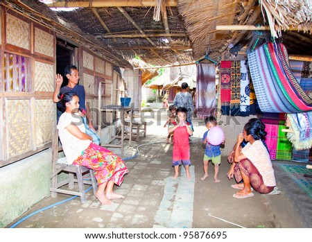 LOMBOK, INDONESIA - FEBRUARY 14: Sasak unidentified family in the village Sade, 4 February , 2004 at Lombok, Indonesia. The Sasak are the most famous tribe in Lombok. They are farmers mainly