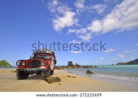 LOMBOK, INDONESIA - JUNE 24: An unnamed driver completes a beach section during the MROC off roading trials event at Lombok Beach on June 24, 2012 in Indonesia - stock photo