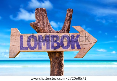 Lombok wooden sign with beach background - stock photo