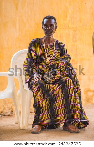 LOME, TOGO - MAR 9, 2013: Unidentified Togolese man in traditional clothes. People of Togo suffer of poverty due to the unstable economic situation.