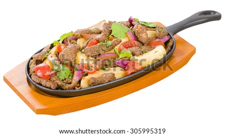 Lomo Saltado - Traditional Peruvian stir-fry with beef, red onions, tomatoes and fries garnished with parsley and coriander. - stock photo