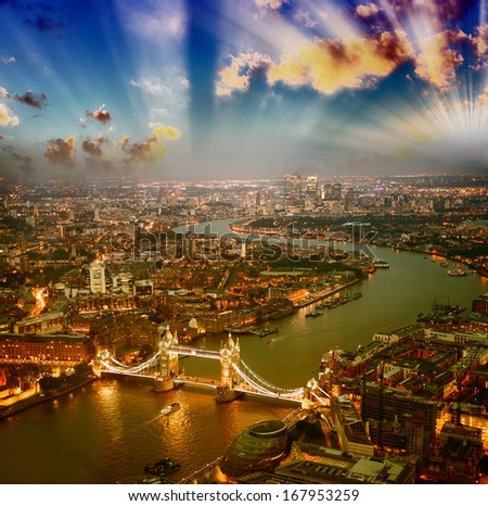 London. Aerial view of Tower Bridge at dusk with beautiful city skyline. - stock photo