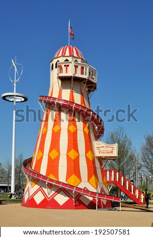 LONDON - APRIL 16. A Helter Skelter on April 16, 2014, at the new Queen Elizabeth Olympic Park, a landscaped public area with entertainment, recreation and sports attractions in Stratford, London. - stock photo