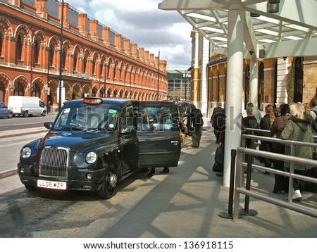LONDON - APRIL 29 : A London Taxi or 'Black Cab' at St.Pancras on April 29, 2013 in London, UK. All London cabs undergo a strict annual mechanical test before they are allowed to ply for hire. - stock photo