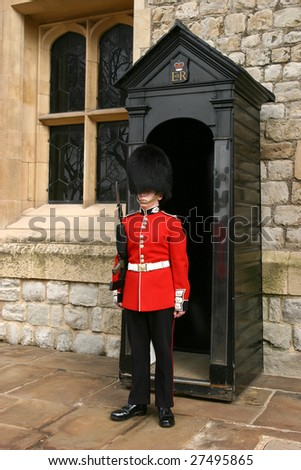 LONDON - APRIL 17: A member of the England Queens' Guard stands guard at London Tower April 17, 2004 in London, England. They are in charged with guarding the official royal residences in London. - stock photo