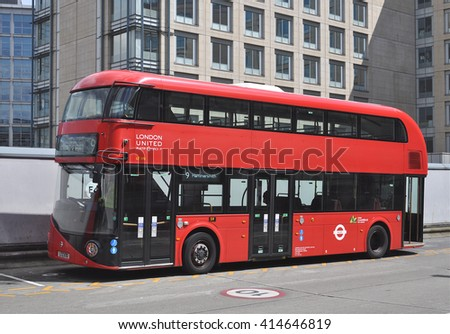 LONDON APRIL 28, 2016. A Routemaster diesel-electric hybrid double deck bus accommodates 80 passengers with three doorways and two staircases, at Hammersmith Bus Station, west London, UK. - stock photo