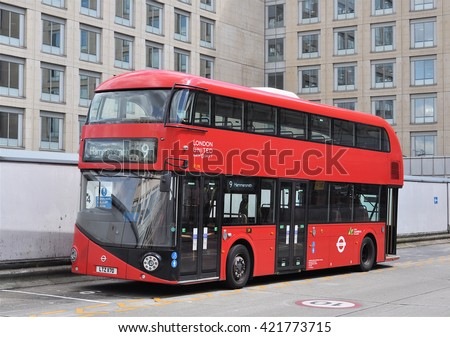 LONDON - APRIL 20, 2016. A Routemaster diesel-electric hybrid double deck bus, unusally seen here without applied advertising, at Hammersmith bus station, west London, UK. - stock photo