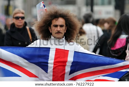LONDON - APRIL 29: An unidentified street seller offers flags for sale at Trafalgar Square in celebration of the wedding of Prince William and Catherine Middleton on April 29 2011 in London, England. - stock photo