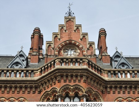 LONDON - APRIL 10. 2016. Architectural detail of the restored 1868 Victorian Gothic style St Pancras railway station and hotel designed by Sir George Gilbert Scott, located in London, UK. - stock photo