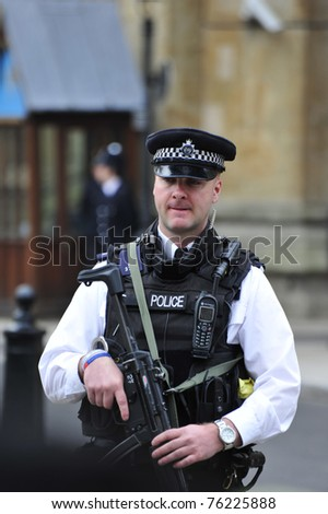 LONDON - APRIL 29 - Armed Police make their presence obvious during the Royal Wedding of Prince William and Kate Middleton April 29, 2011 at Westminster Abbey in London, England. - stock photo