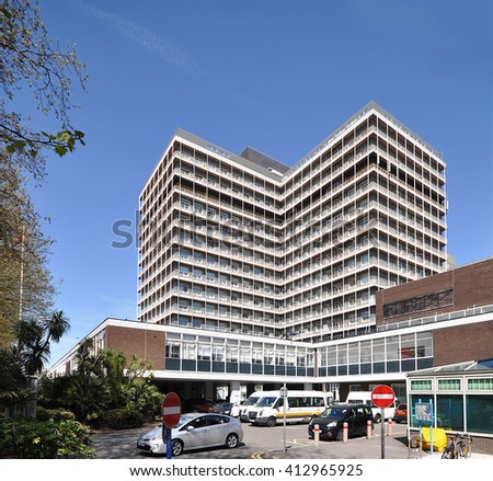 LONDON - APRIL 20, 2016. Charing Cross Hospital is a 15 storey 511 bed hospital designed in the shape of a cross by Ralph Tubbs and opened in 1973 in the Borough of Hammersmith & Fulham, London. - stock photo