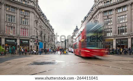 LONDON - APRIL 12, 2013: Double decker bus in Crossroad between Regent and Oxford street. Regent St. is one of the major shopping streets in London, well known to tourists and Londoners.Stock video: - stock photo