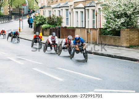 LONDON - APRIL 26: Elite wheelchair men run the Virgin Money London Marathon on April 26, 2015 in London, England, UK. - stock photo