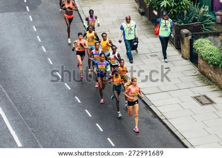 LONDON - APRIL 26: Elite women Felix, Kiplagat, Tufa, Mergia Aselefech, Keitany Mary and Tsegaye Tirfi run the Virgin Money London Marathon on April 26, 2015 in Isle of Dogs, London, England, UK. - stock photo