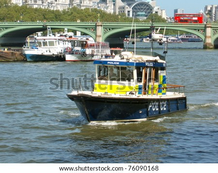 LONDON - APRIL 27. Heightened security preceding the Royal Wedding sees a Police launch patrolling the River Thames at Westminster Bridge in London,  April 27, 2009
