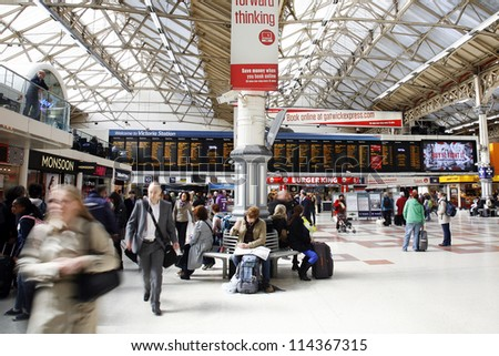 LONDON - APRIL 30 : Inside view of Victoria Station, since 1860, second busiest railway terminus after Waterloo, served 73 million passenger between 2010 - 2011, on April 30, 2012, London, UK. - stock photo