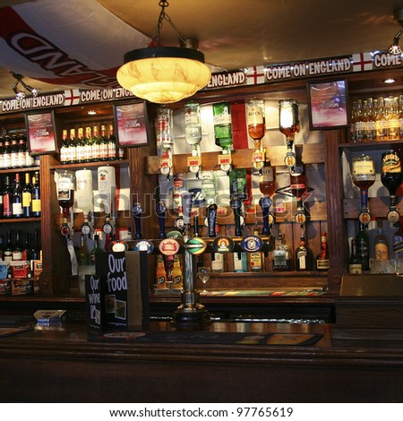 LONDON - APRIL 12: Interior of pub, for drinking and socializing, focal point of the community, on April 12, 2006, London, UK. Pub business, now about 53,500 pubs in UK, has been declining every year - stock photo