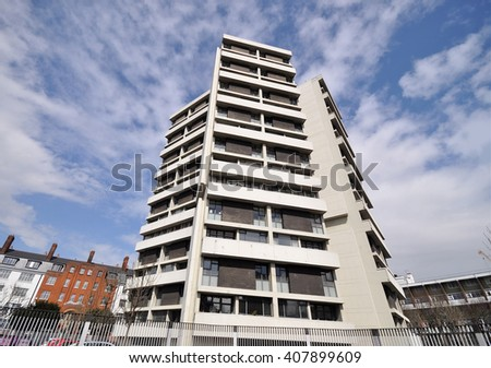 LONDON - APRIL 9, 2016. Keeling House is a 16 storey Modernist four wing Grade II Listed apartment building designed by Denys Lasdun, completed in 1957 and renovated in 2001, Bethnall Green, London. - stock photo