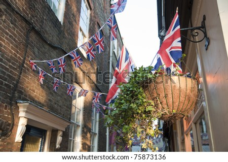 LONDON - APRIL 24: London hangs up buntings for Prince William and Catherine Middleton's royal wedding celebration to take place April 29 at Westminster Abbey. April 24, 2011 in London, England. - stock photo