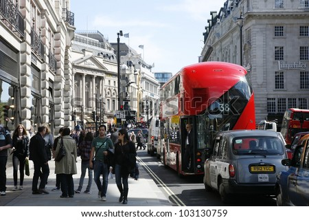LONDON - APRIL 30: London's new bus, also called Boris Bus or hybrid NB4L, 50% more fuel efficient, on April 30, 2012, London, UK. It is a 21st century replacement of the iconic Routemaster for London