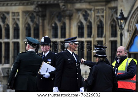 LONDON - APRIL 29 - Members of the Police security forces finalize logistics for the Royal Wedding of Prince William and Kate Middleton April 2, 2011 at Westminster Abbey in London - stock photo