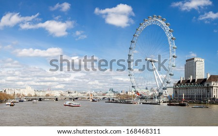 LONDON - APRIL 6: Panorama of London Eye, on April 6, 2012 in London. The largest Ferris wheel in Europe, structure of the London Eye is 135 M. tall and the wheel has a diameter of 120 M. - stock photo