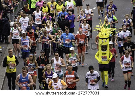 LONDON - APRIL 26: Participant wearing funny costume in the runners of London Marathon on April, 26, 2015 in London, UK. London Marathon is a World Marathon Majors.   - stock photo