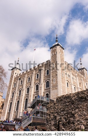 LONDON  APRIL 6 2015: People climbing steps to the White Tower in the Tower of London. The Tower is a historic castle built by William the Conqueror in 1078 on the north bank of the Thames.