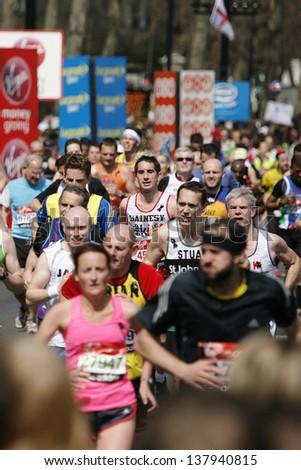 LONDON - APRIL 21: Runners in the London Marathon on April, 21, 2013 in London, UK. The London Marathon is next to New York, Berlin, Chicago and Boston to the World Marathon Majors, Champions League  - stock photo