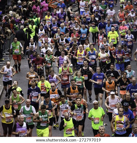 LONDON - APRIL 26: Runners in the London Marathon on April, 26, 2015 in London, UK. The London Marathon is next to New York, Berlin, Chicago and Boston to the World Marathon Majors, Champions League - stock photo