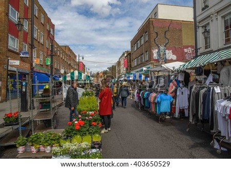 LONDON - APRIL 9, 2016: Shoreditch, in the heart of the trendy East End of London, has become synonymous with the UK street art scene, attracting visitors from all over the world. - stock photo