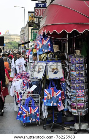 LONDON - APRIL 29 - Souvenirs and memorabilia celebrating the Royal Wedding of Prince William and Kate Middleton are on sale at local vendors on April 29, 2011 at Westminster Abbey in London, England. - stock photo