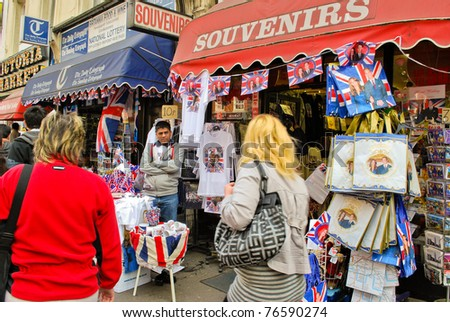 LONDON - APRIL 29 - Souvenirs and memorabilia celebrating the Royal Wedding of Prince William and Kate Middleton are on sale at local vendors on April 29, 2011 near Buckingham Palace in London. - stock photo