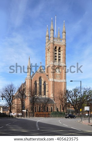 LONDON - APRIL 10, 2016. St Paul's is a grade two listed Anglican church designed in Early English Gothic revival style and consecrated in 1883 at Hammersmith, west London, UK. - stock photo