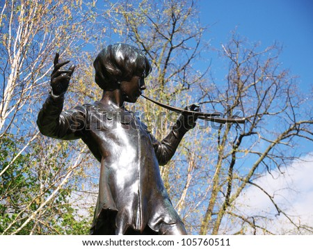 LONDON - APRIL 21: Statue of famous fairytale character Peter Pan, the boy who would never grow up and was created by author J.M. Barrie, in Kensington Gardens in London on April 21, 2012.
