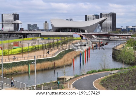 LONDON - APRIL 16. The Aquatics Centre at the new Queen Elizabeth Olympic Park on April 16, 2014, designed by Zaha Hadid Architects, now open to the public at Stratford, east London, UK. - stock photo