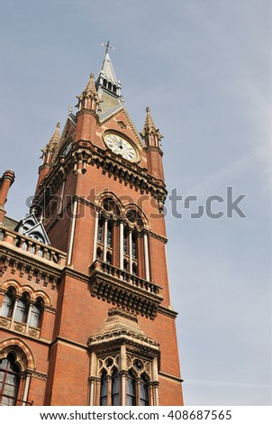 LONDON � APRIL 10. 2016. The clock tower at the restored 1868 St Pancras International railway station and hotel, designed by Sir George Gilbert Scott, located in the King's Cross area of London. - stock photo