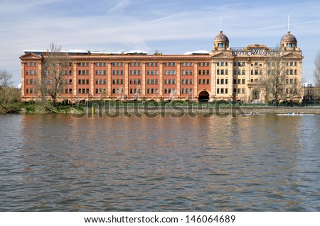 LONDON - APRIL 21. The Harrods Furniture Depository overlooking the River Thames was built for storing large retail products, now converted to residential use, April 21, 2013 in Barnes, London, UK.
